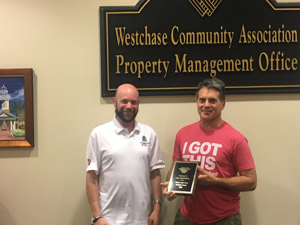 WCA President Shawn Yesner, left, presents Nathan Lafer Good Neighbor Award to Alan Shabott.